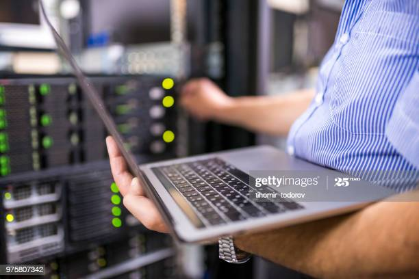 Engineer in the server room close-up. Photo taken at a Data Center in Bulgaria, Eastern Europe.  อีเมล์ธุรกิจ, อีเมล์บริษัท gettyimages 975807342 612x612 1